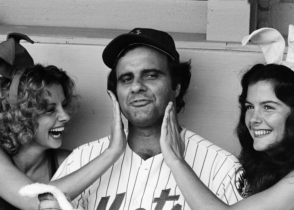 Torre enjoys the company of two Playboy Playmates before a Mets-Cubs game. (AP)