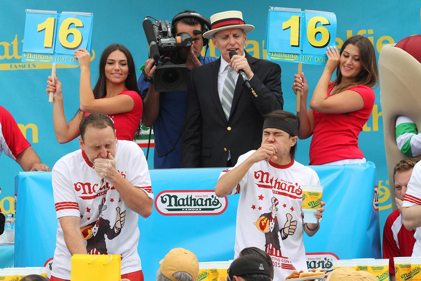 Joey Chestnut, left, and Matt Stonie compete in Nathan's Famous Fourth of July International Hot Dog Eating Contest. Stonie came in first, eating 62 hot dogs and buns in 10 minutes. Chestnut ate 60 hot dogs and buns in 10 minutes.