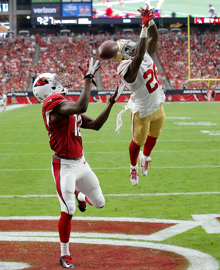 John Brown of the Arizona Cardinals can't make this catch against Kenneth Acker of the 49ers.