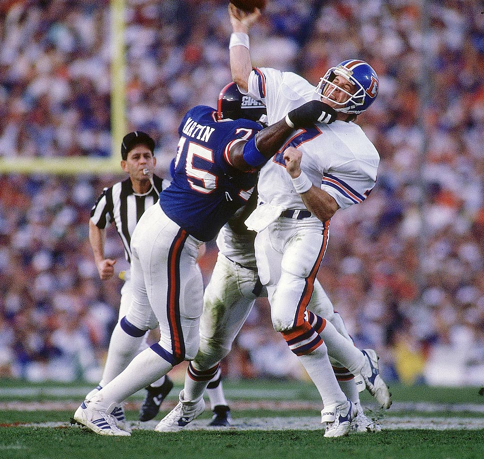 George Martin wallops John Elway during a January 1987 New York Giants-Denver Broncos game.