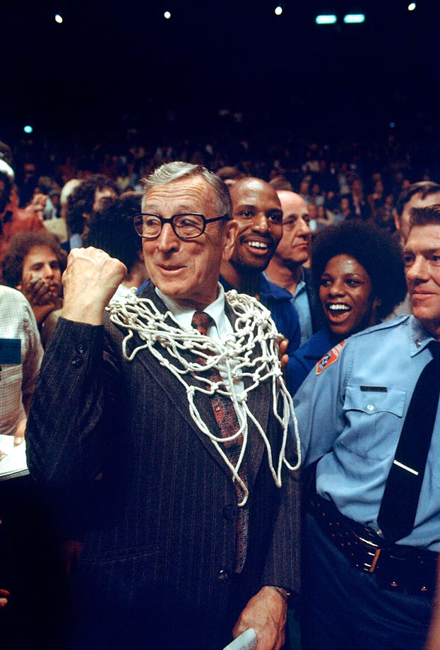 UCLA coach John Wooden pumps his fist after a 92-85 victroy over Kentucky in the 1975 title game in San Diego.