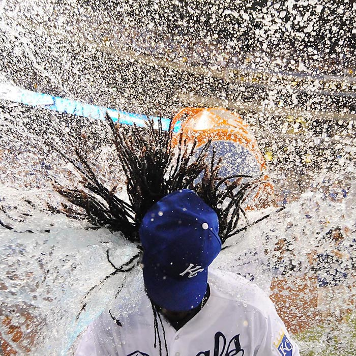 Johnny Cueto of the Kansas City Royals is doused by Salvador Perez after throwing a complete game shutout against the Detroit Tigers.