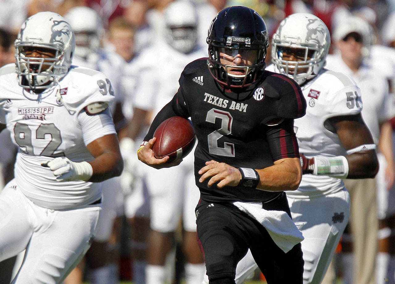 Johnny Manziel runs past Mississippi State defensive lineman Kaleb Eulls for a touchdown in the second quarter against the Bulldogs on Nov. 3, 2012.