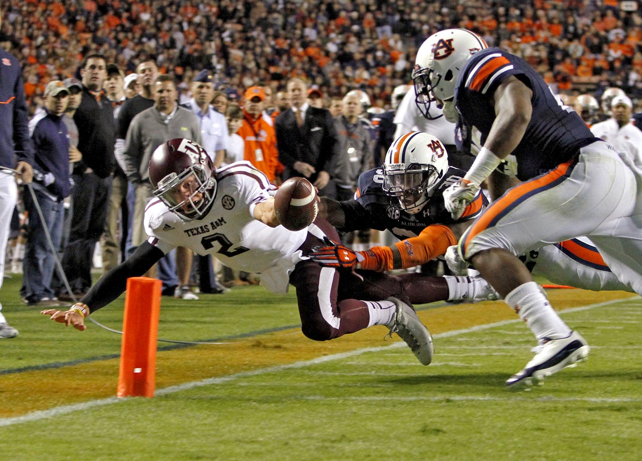 Johnny Manziel dives for a touchdown past Auburn linebackers Cassanova McKinzy and Daren Bates on Oct. 27, 2012.