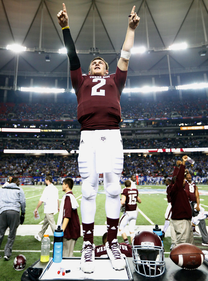Johnny Manziel celebrates late in the game against the Duke Blue Devils during the Chick-fil-A Bowl on Dec. 31, 2013 at the Georgia Dome in Atlanta. The Aggies were down 38-17 at halftime but with Manziel at the helm they came back to win 52-48. He threw four touchdown passes, completed 30 of 38 passes for 382 yards and ran for 73 yards and a touchdown.