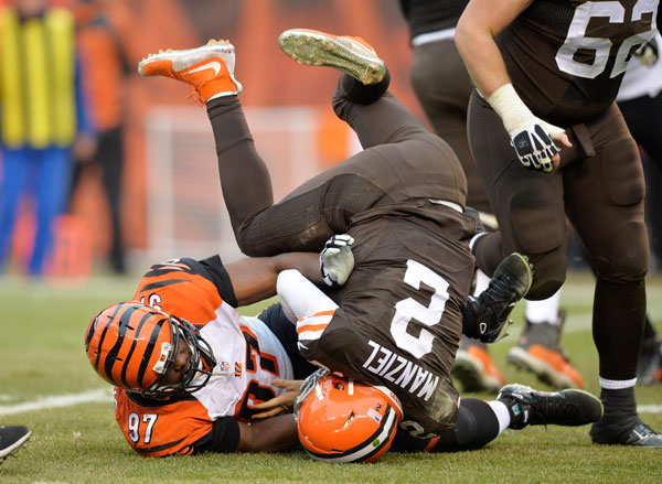 Johnny Manziel and Geno Atkins :: AP