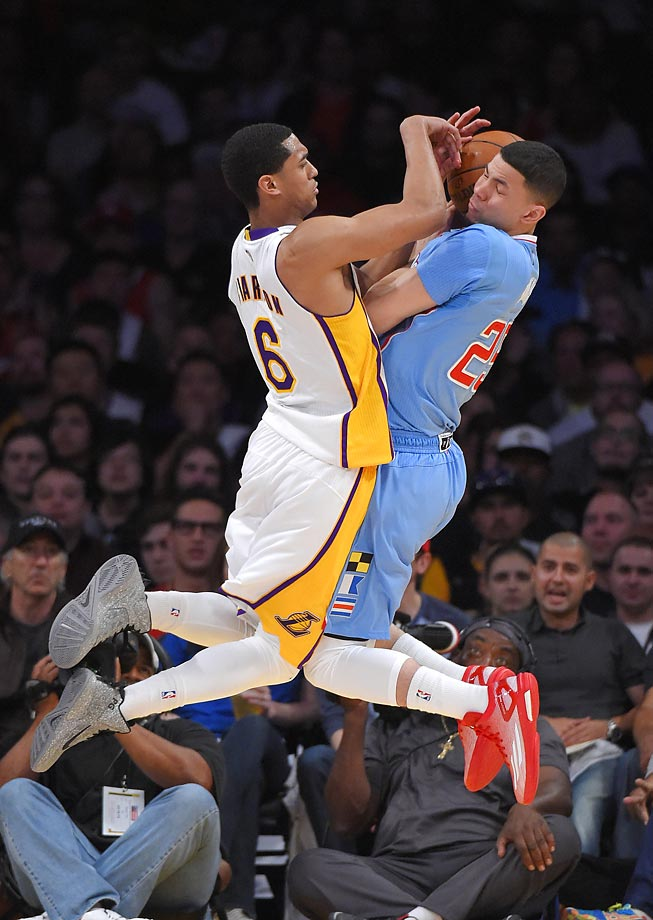 Jordan Clarkson of the Lakers fouls Austin Rivers.  The Clippers won 106-78.