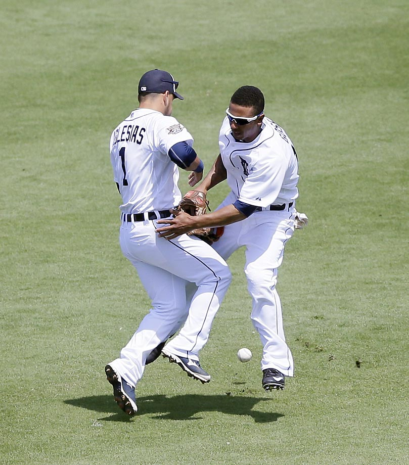 Shortstop Jose Iglesias and centerfielder Anthony Gose of the Detroit Tigers misplay a ball against the Cardinals that resulted in a two-run double.