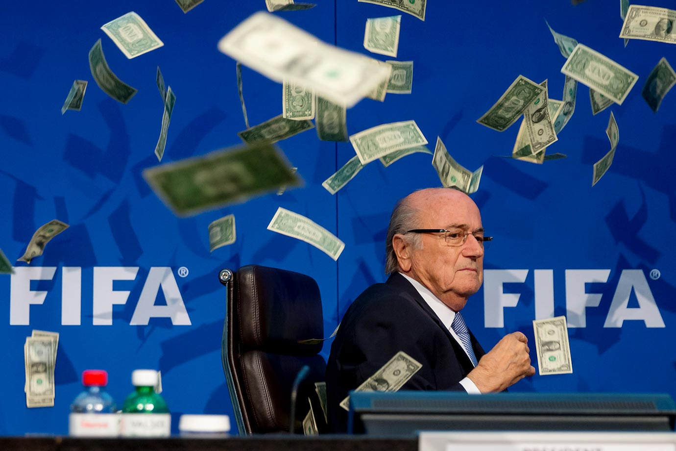Comedian Simon Brodkin (not pictured) throws cash at FIFA President Sepp Blatter during a press conference in Zurich, Switzerland.