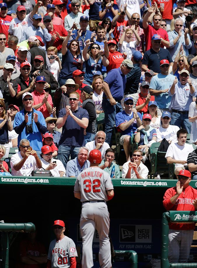 The Texas Rangers gave their fans plenty of reasons to cheer in the home opener, beating Josh Hamilton and the Los Angeles Angels 3-2. Hamilton was a five-time All-Star and the 2010 AL MVP while with Texas before going to the AL West-rival Angels with a $125 million, five-year contract over the winter. He finished 0 for 4 -- he was booed during pregame introductions and when he came to bat each time. Those boos became cheers when he took a strike on the first pitch in the second inning, and the sellout crowd of 48,845 erupted when he struck out swinging. After striking out again in the fourth, Hamilton lined out in the sixth and flied out in the ninth.