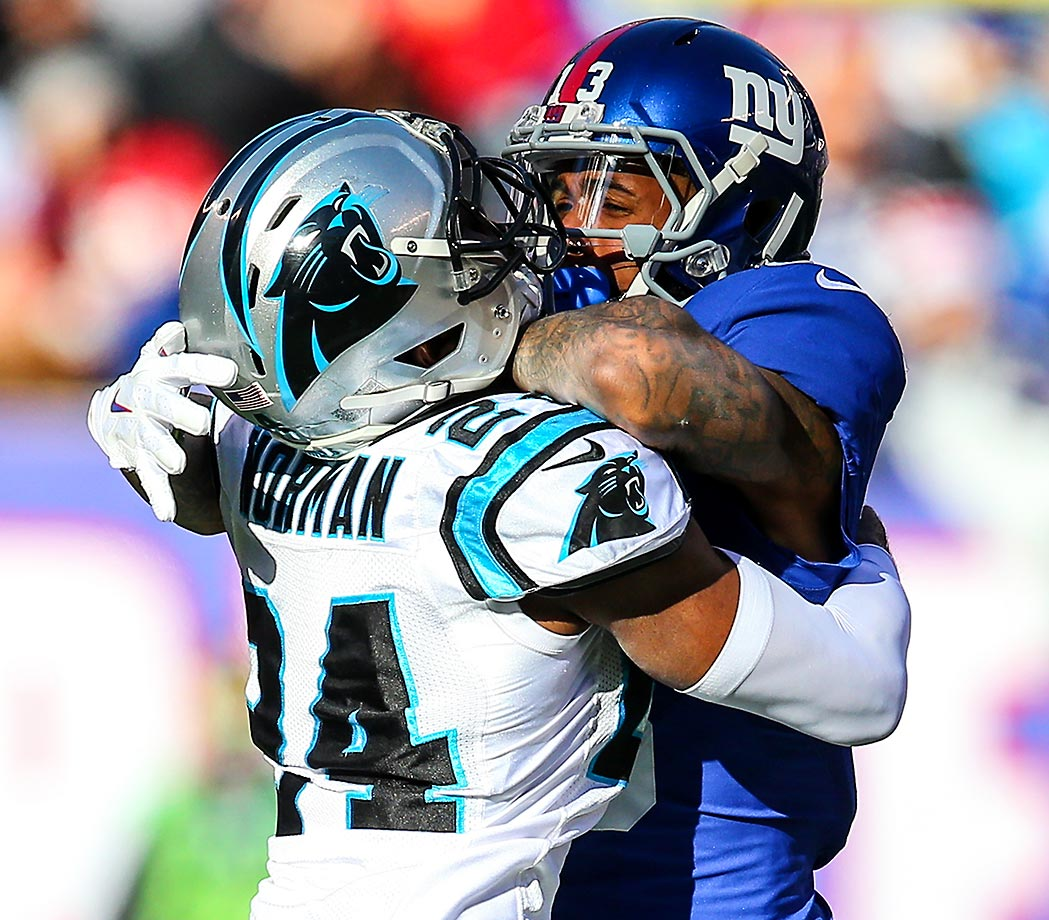 Josh Norman of the Carolina Panthers gets tangled up with Odell Beckham of the New York Giants.