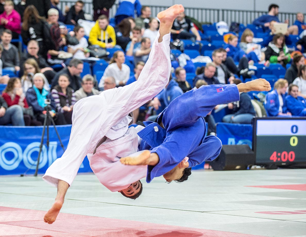 Renz Vallejera (blue) throws Lewis Mark for an ippon in the u66kg category during the 2015 British Junior Judo Championships.
