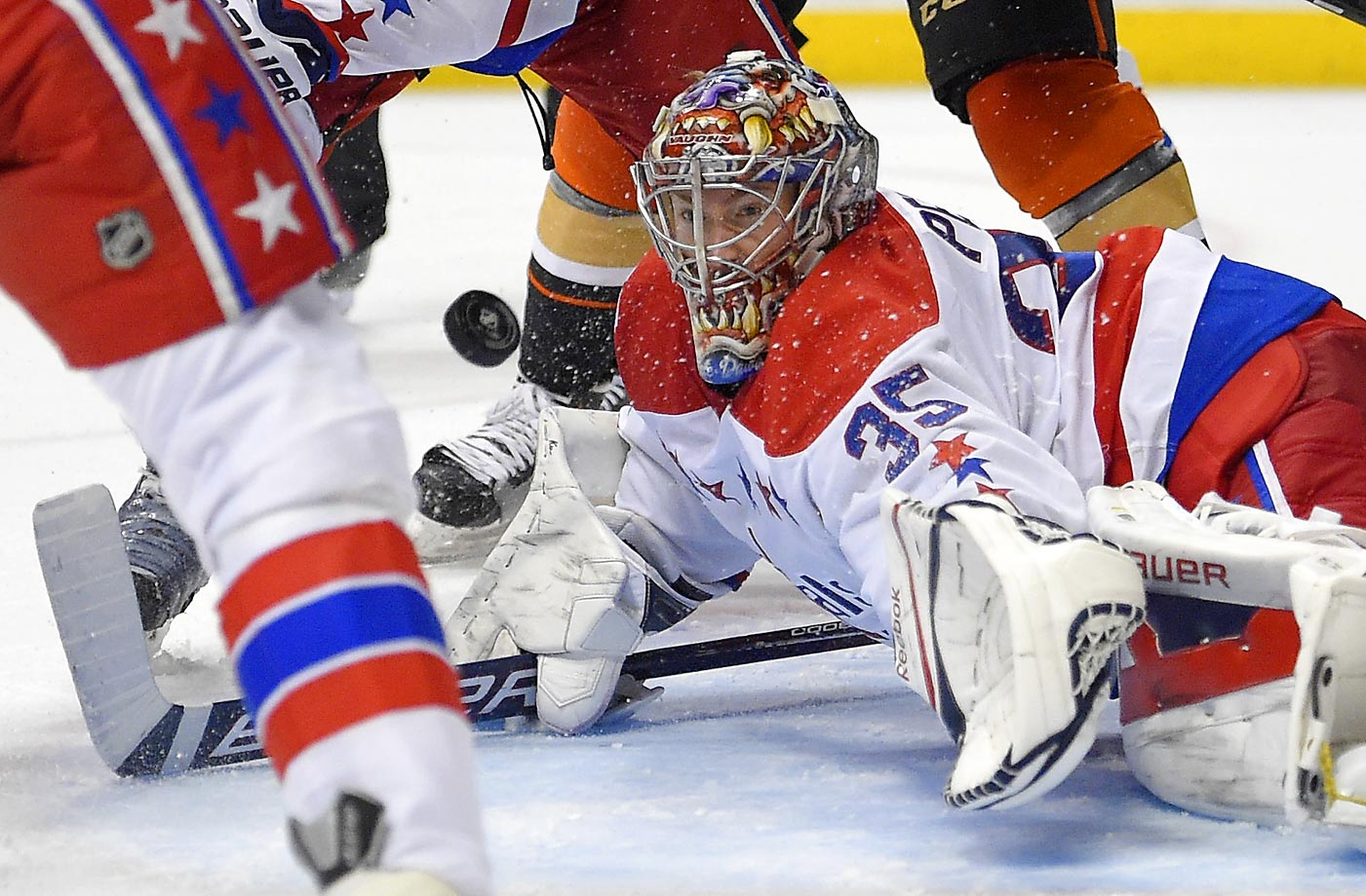 Washington Capitals goalie Justin Peters stops a shot during the second period against the Anaheim Ducks.