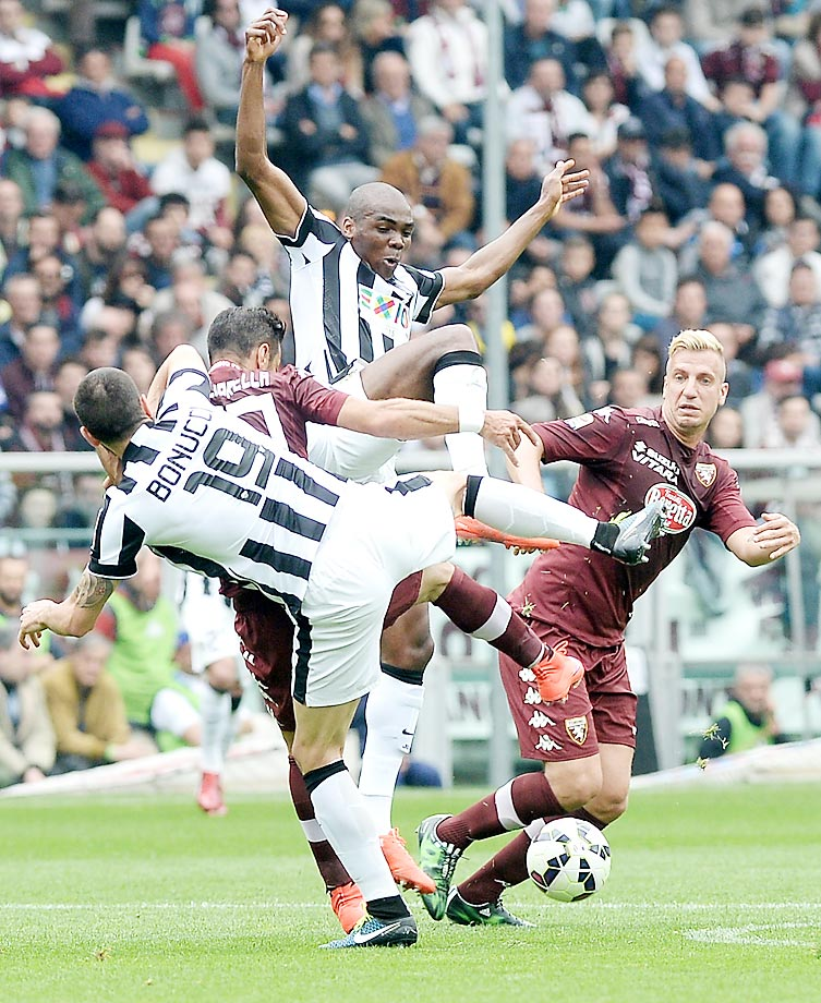 From left, Juventus' Leonardo Bonucci, Torino's Fabio Quagliarella, Juventus' Angelo Ogbonna and Torino's Maxi Lopez go for the ball during a Series A match at the Olympic stadium in Turin.
