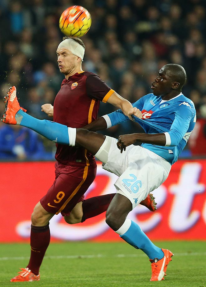 Kalidou Koulibaly (right) of Napoli goes up against Edin Dzeko of Roma during a Serie A match.