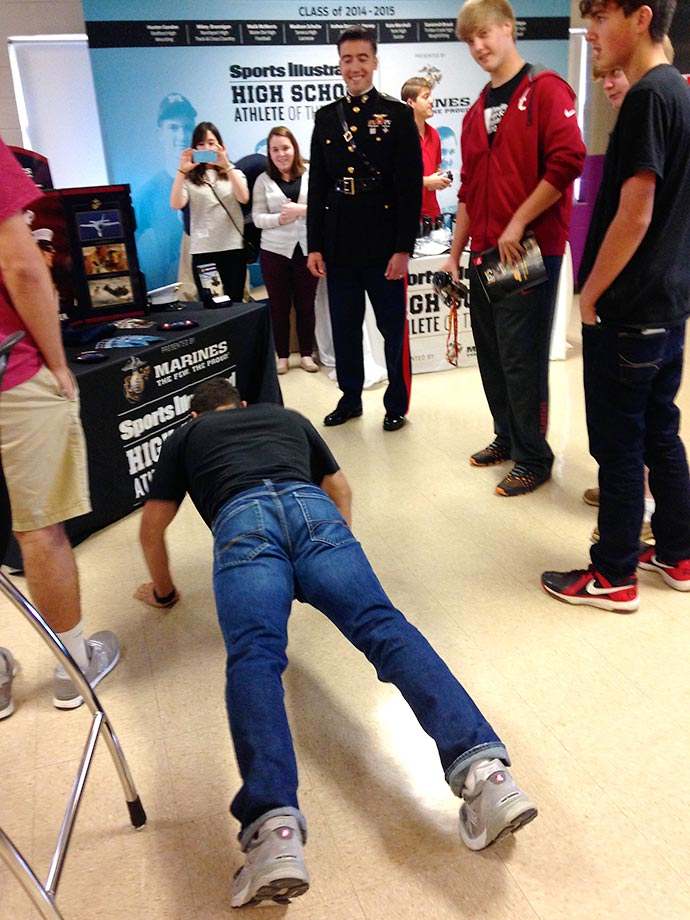 A spontaneous push-up contest broke out during the event presented by the U.S. Marine Corps to recognize Kane Hogan as Sports Illustrated's High School Athlete of the Month.