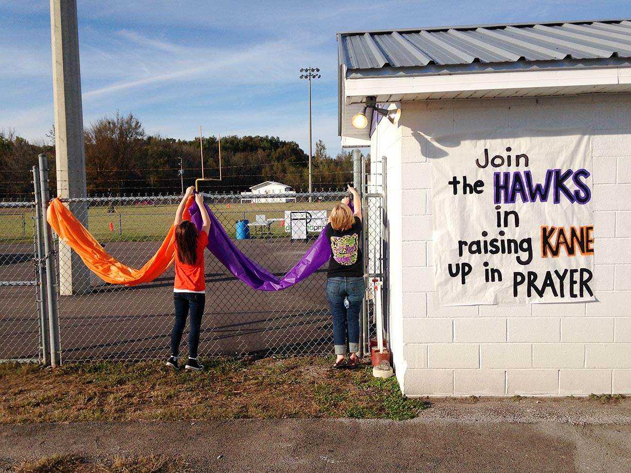 Team boosters decorate the football stadium. Kane's community would raise nearly $1,200 during the game that evening to donate to his family's expenses.
