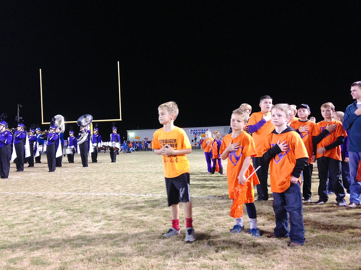 Though the Falkville Blue Devils' school colors are blue and white and the Danville Hawks' are purple and black, almost the entire crowd wore orange—the official color of blood cancer awareness—in honor of Kane.