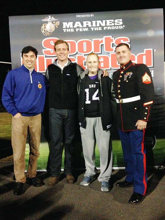 On Friday, Oct. 30, Sports Illustrated traveled to Danville, Ala., and brought along special guest, former Alabama quarterback John Parker Wilson, to recognize Kane Hogan of the Danville High football team as the SI High School Athlete of the Month for September, presented by the U.S. Marine Corps. Picured from left to right are: SI managing editor Chris Stone, Wilson, Kane, and Sgt Lucas Spann of the U.S. Marine Corps.