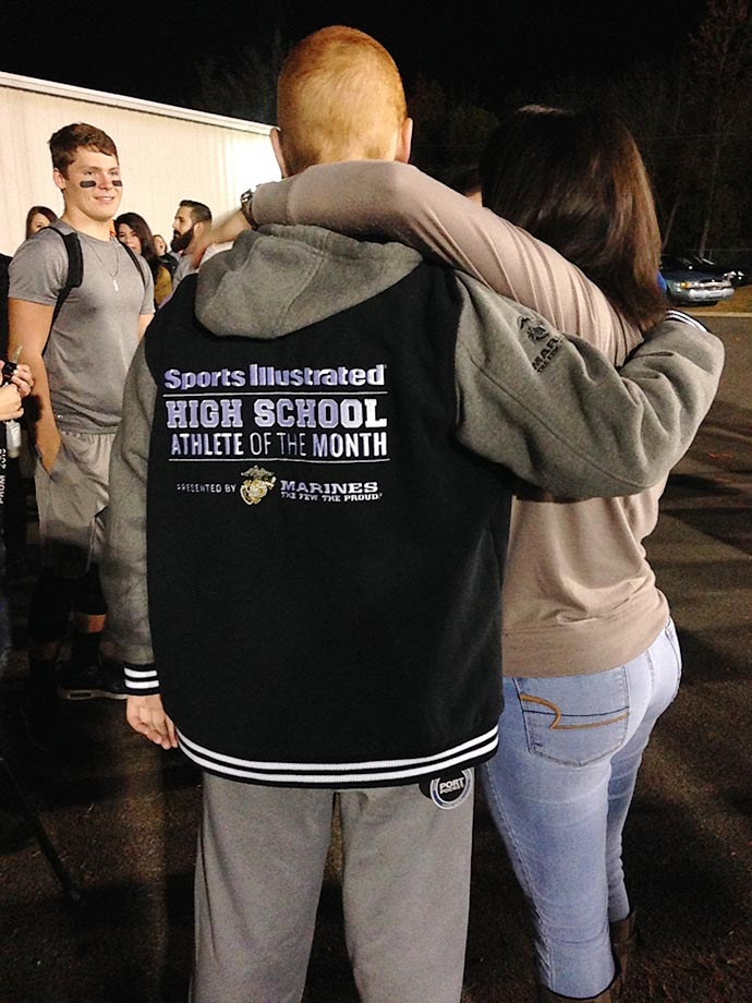Kane sported his new letterman's jacket as he was greeted by friends after the game.