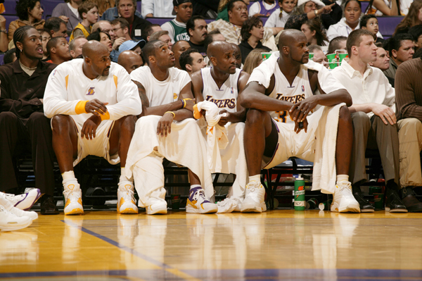 Malone is joined by Kobe Bryant, Gary Payton and Shaquille O'Neal on the bench during a game Nov. 2003 game against Golden State.  (John W. McDonough/SI)