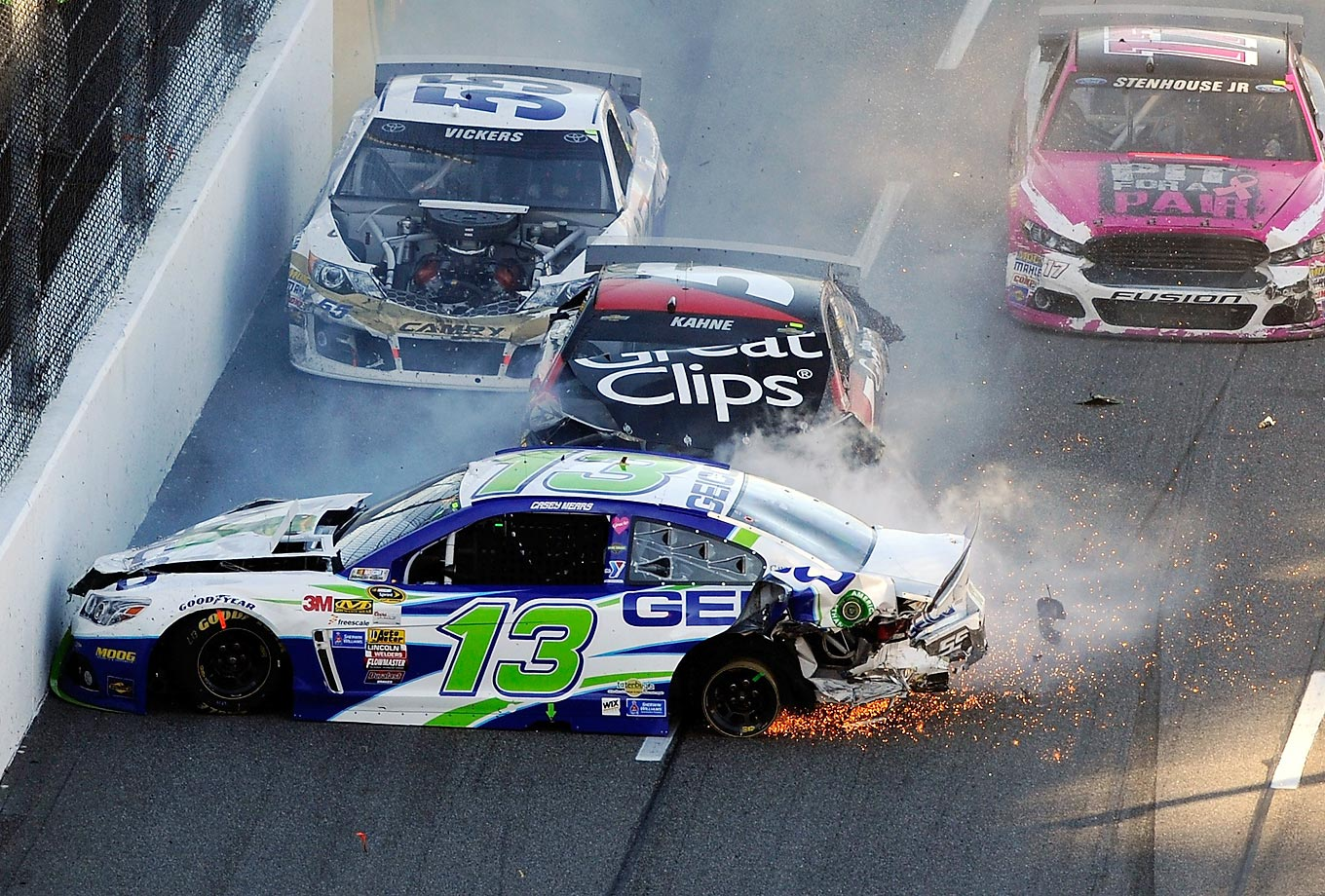 Casey Mears, Kasey Kahne and Brian Vickers crash during the NASCAR Sprint Cup Series Goody's Headache Relief Shot 500 at Martinsville Speedway.