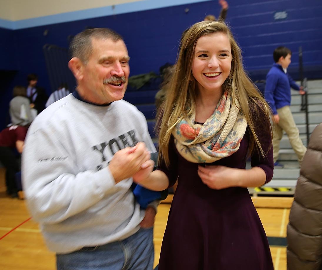 York High varsity girls' soccer coach Walter Caldwell congratulates his starting center midfielder.