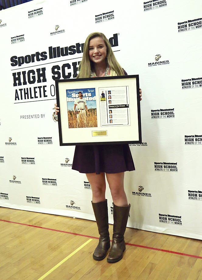 Sports Illustrated traveled to York, Maine on Dec. 18 to honor York High sophomore, Kate Marshall as December's SI High School Athlete of the Month, presented by the U.S. Marine Corps. The starting center midfielder for the Wildcats' girls' soccer team, Kate also has cystic fibrosis, a chronic, life-threatening genetic disease. Along with her father Patrick, mother Martha and brother Chase, she was honored at half-time of a home basketball game with a framed copy of the issue she appeared in earlier this month. Kate also received a surprise video message of congratulations from former NFL quarterback and prominent CF awareness advocate, Boomer Esiason.   (click to video here: video here: http://www.si.com/high-school/2014/12/19/boomer-esiason-message-kate-marshall-cystic-fibrosis)