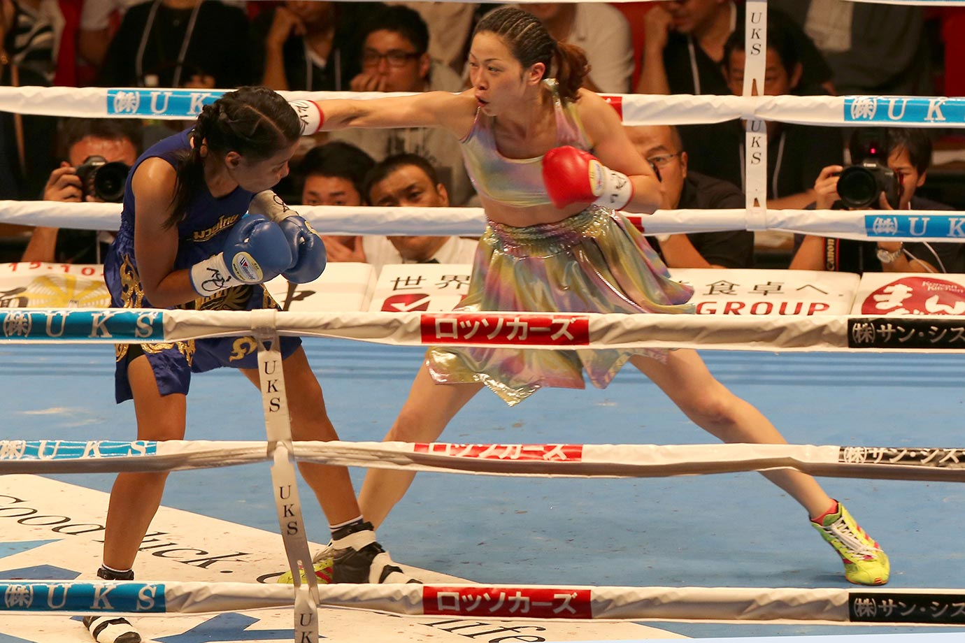 Kei Takenaka (right) of Japan gets dressed up for her fight against Krikanok Islandmuaythai during the OPBF light flyweight title bout at the Osaka Prefectural Gymnasium in Osaka, Japan.