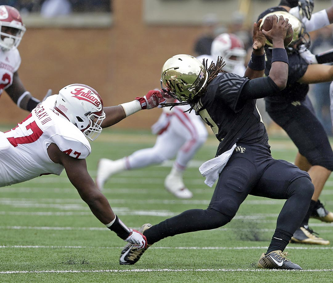 Kendall Hinton of Wake Forest is pulled down by Robert McCray III of Indiana. McCray was called for a personal foul.