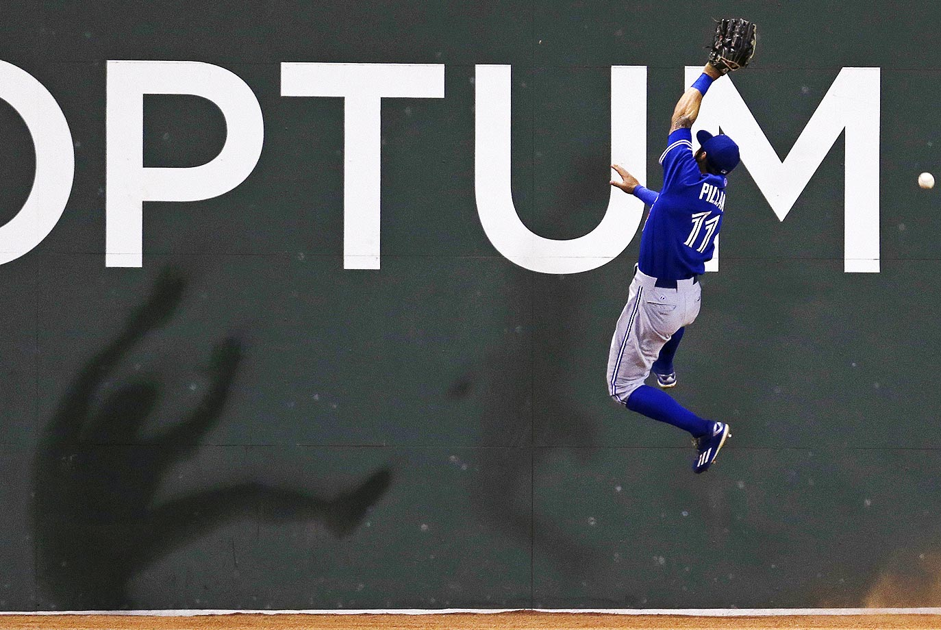 Kevin Pillar of the Toronto Blue Jays can't make a play against the Boston Red Sox.