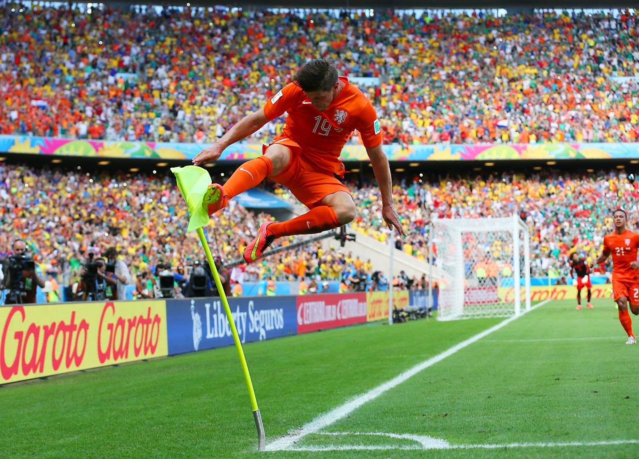 "The ""Hunter"" moonlights as a ninja: Dutch striker Klaas-Jan Huntelaar celebrates his penalty-kick goal, which eliminated Mexico from the World Cup."