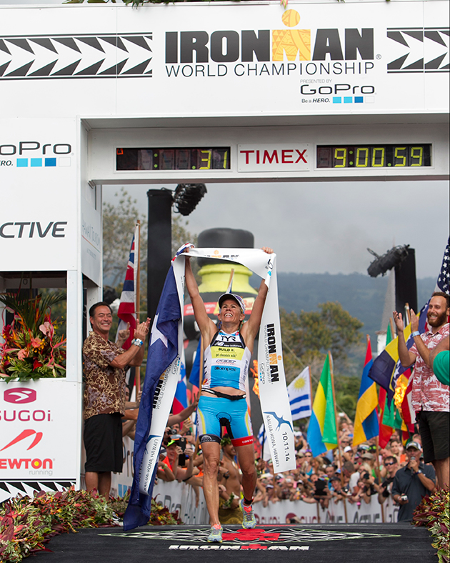 Mirinda Carfrae, of Australia, wins the woman's 2014 IRONMAN World Championship in Kailua Kona, Hawaii. Carfrae overcame the largest deficit in IRONMAN history, winning the race after closing a 14 and a half minute gap between second place finisher Daniela Ryf, of Switzerland.