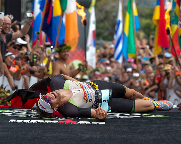 Sebastian Kienle, of Germany, reacts after winning the men's 2014 IRONMAN World Championship.