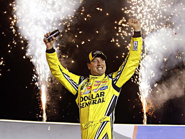 Kyle Busch celebrates in Victory Lane after winning NASCAR's Camping World Truck Series race at Kentucky Speedway in Sparta, Ky.