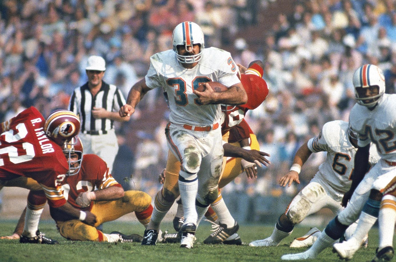Miami Dolphins fullback Larry Csonka charges up the middle against the Washington Redskins in Super Bowl VII, in January 1973.