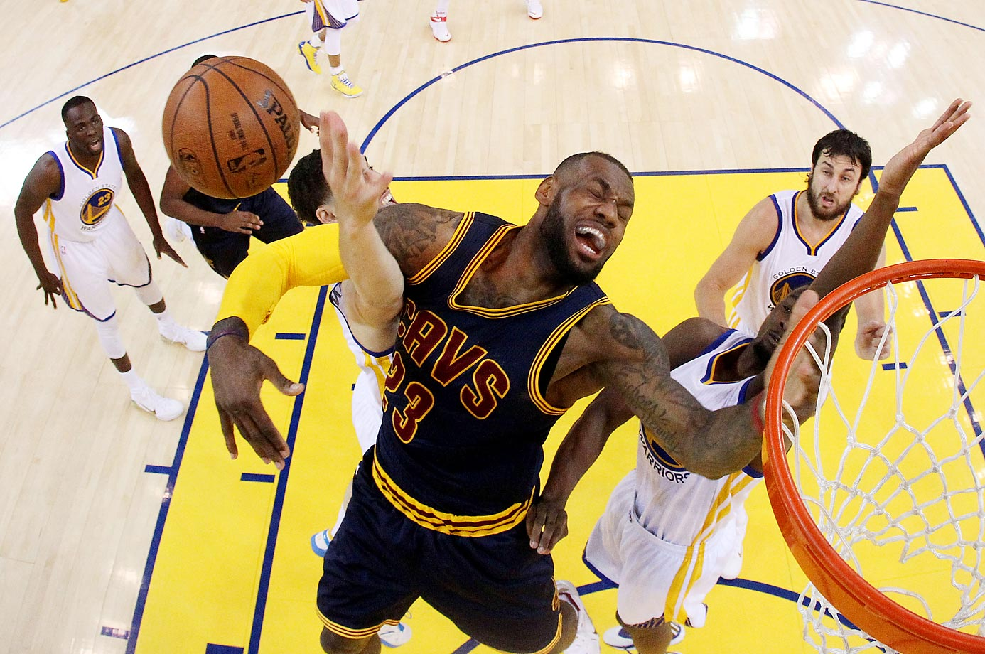 LeBron James gets hacked by Klay Thompson of the Golden State Warriors as he goes up for a shot in Game 1 of the NBA Finals at Oracle Arena on June 4.