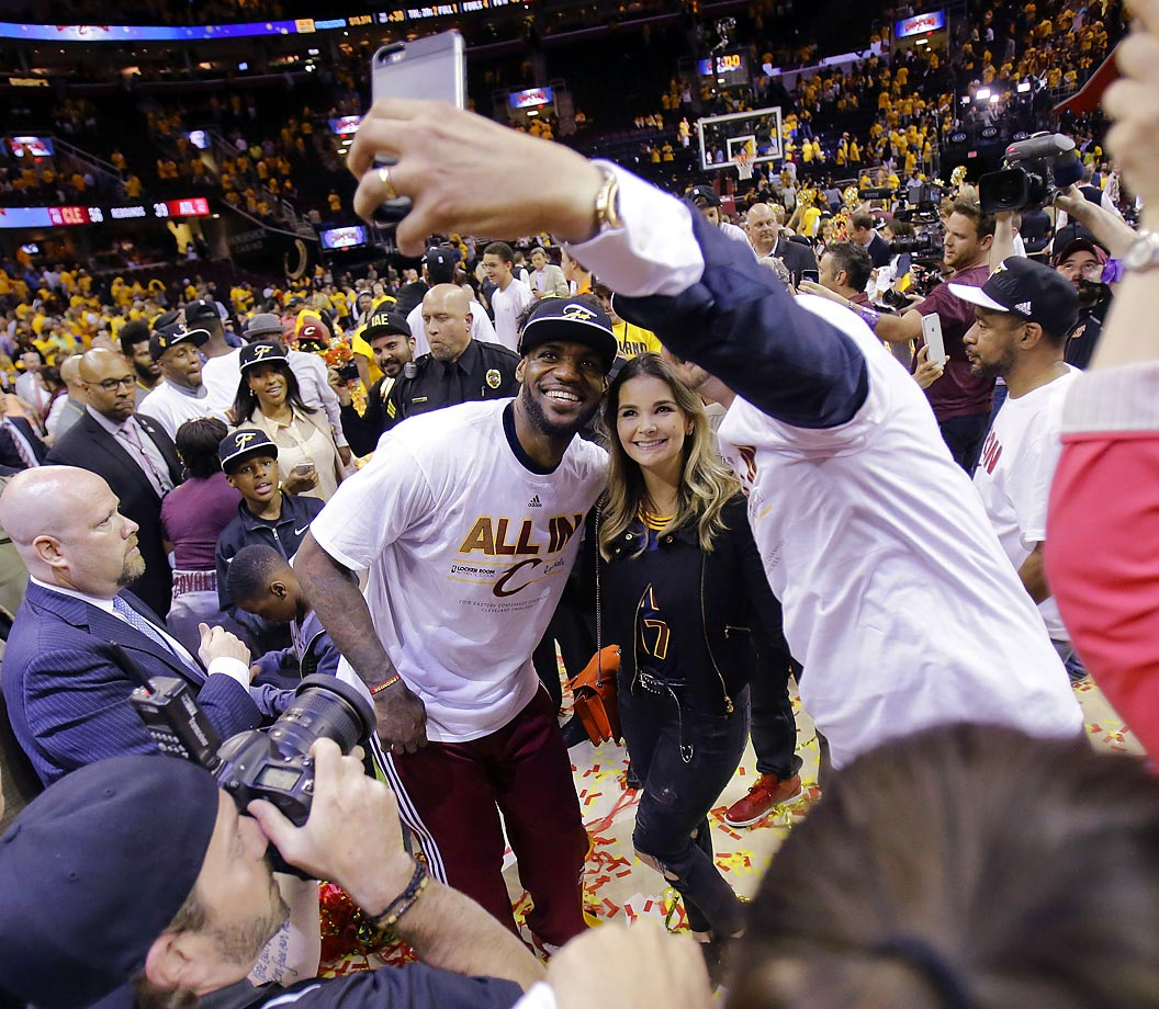 LeBron James poses for a selfie with fans after the Cavaliers defeated the Atlanta Hawks 118-88 in Game 4 of the Eastern Conference finals.