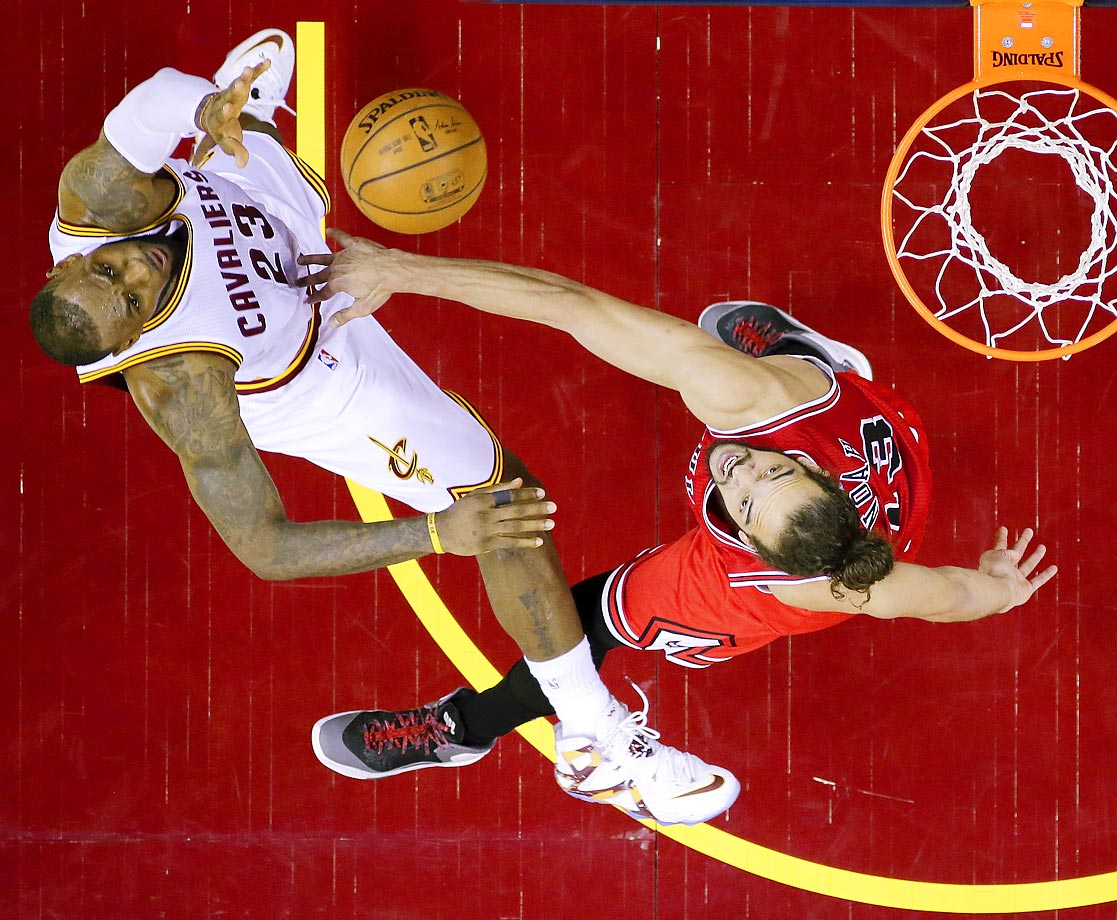 LeBron James of the Cavs shoots over Joakim Noah of the Bulls.