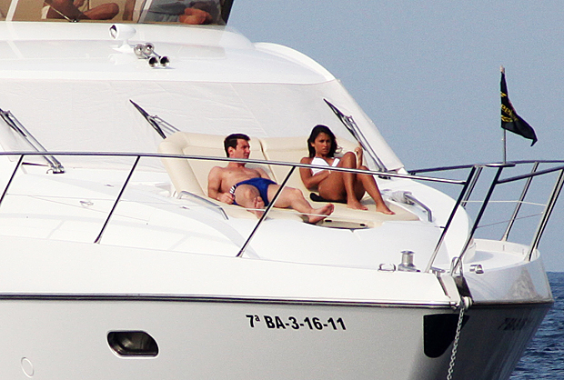 Messi and girlfriend Antonella Rocuzzo work on their tan while in Ibiza, Spain. (Getty Images)