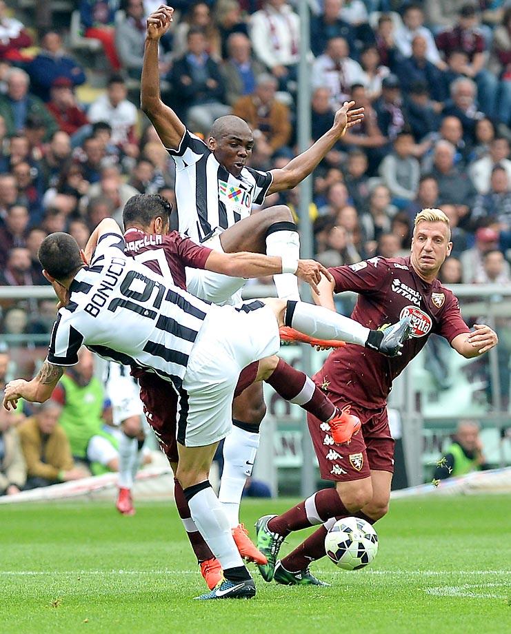 Leonardo Bonucci, Fabio Quagliarella, Angelo Ogbonna and Maxi Lopez get tangled up during a Serie A soccer match between Juventus and Torino.