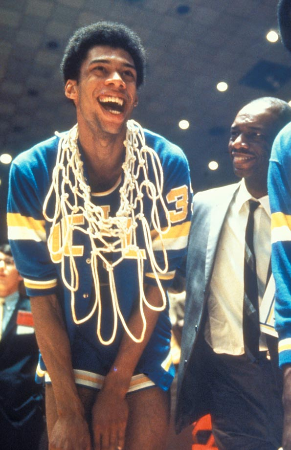 UCLA's Lew Alcindor accepts congratulations from his father after winning the title in 1969 with a 92-72 victory over Purdue.