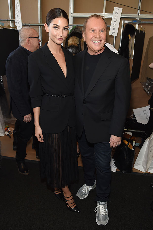 Lily Aldridge poses backstage with designer Michael Kors at NYFW