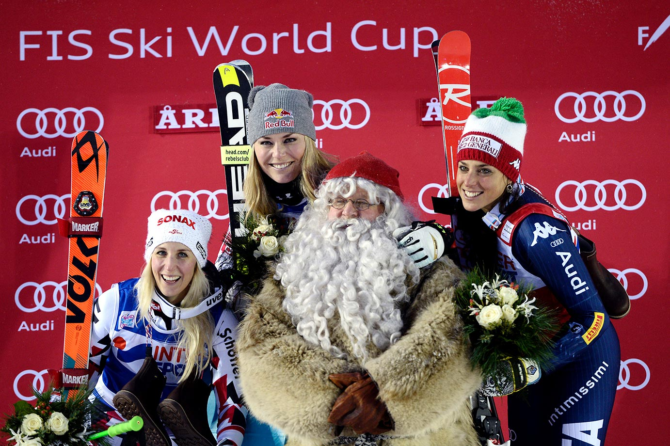 This is one happy Santa at the FIS Ski World Cup with Eva-Maria Brem, Lindsey Vonn and Federica Brignone.