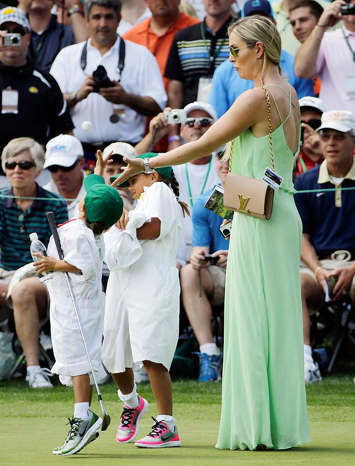 Lindsey Vonn and Tiger's kids, Sam and Charlie, try to catch a ball during the Par 3 at the Masters.