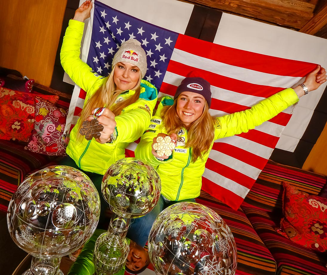American World Championship medallists and World Cup globe winners Lindsey Vonn and Mikaela Shiffrin pose after the Audi FIS Alpine Ski World Cup Finals in France.
