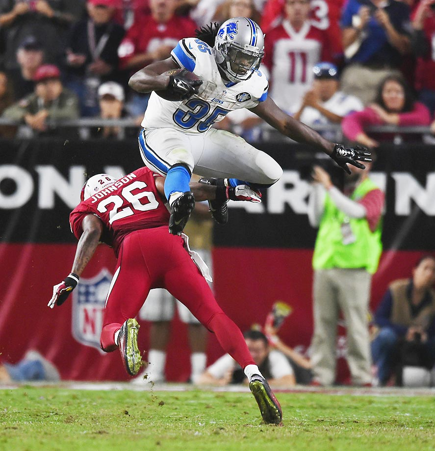 Detroit Lions running back Joique Bell jumps over Arizona Cardinals safety Rashad Johnson during a 14-6 victory.