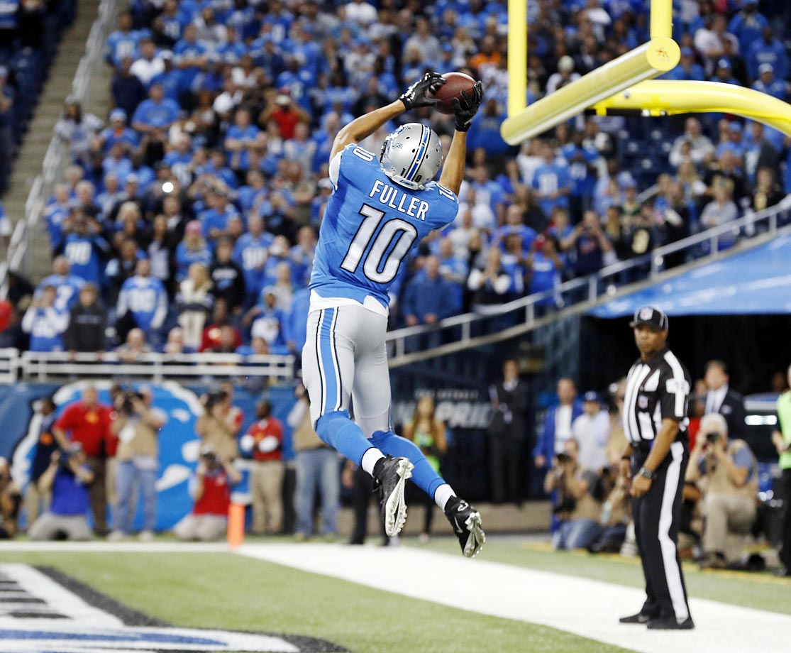 Corey Fuller catches the game-tying touchdown against the Saints with less than two minutes remaining.  The Lions won 24-23 on the extra point.