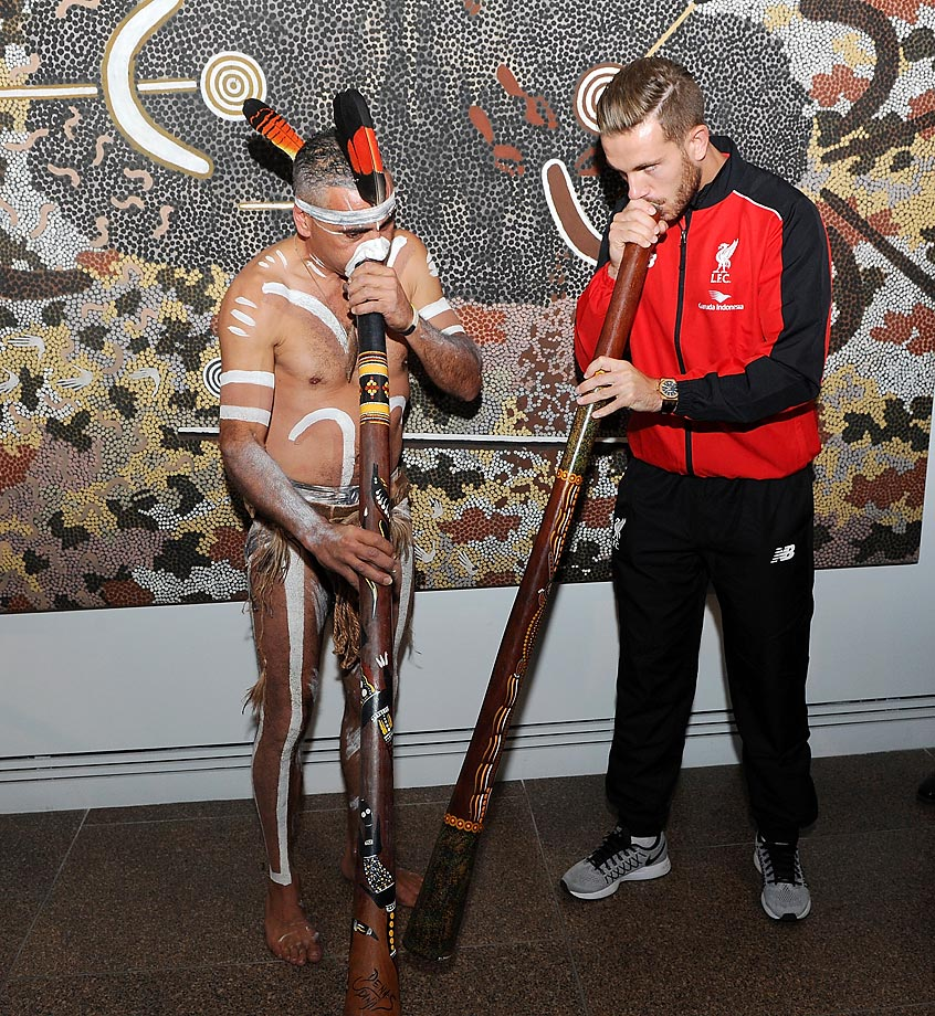 Jordan Henderson of Liverpool talks with Karl Winda Telfer during a cultural visit to the Art Gallery of South Australia.