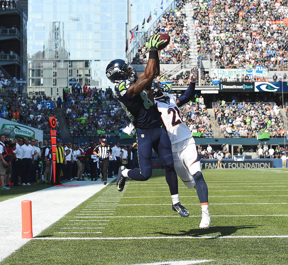 Ricardo Lockette of the Seahawks goes up for a touchdown catch against Broncos. The                     Seahawks won 26-20 in overtime.